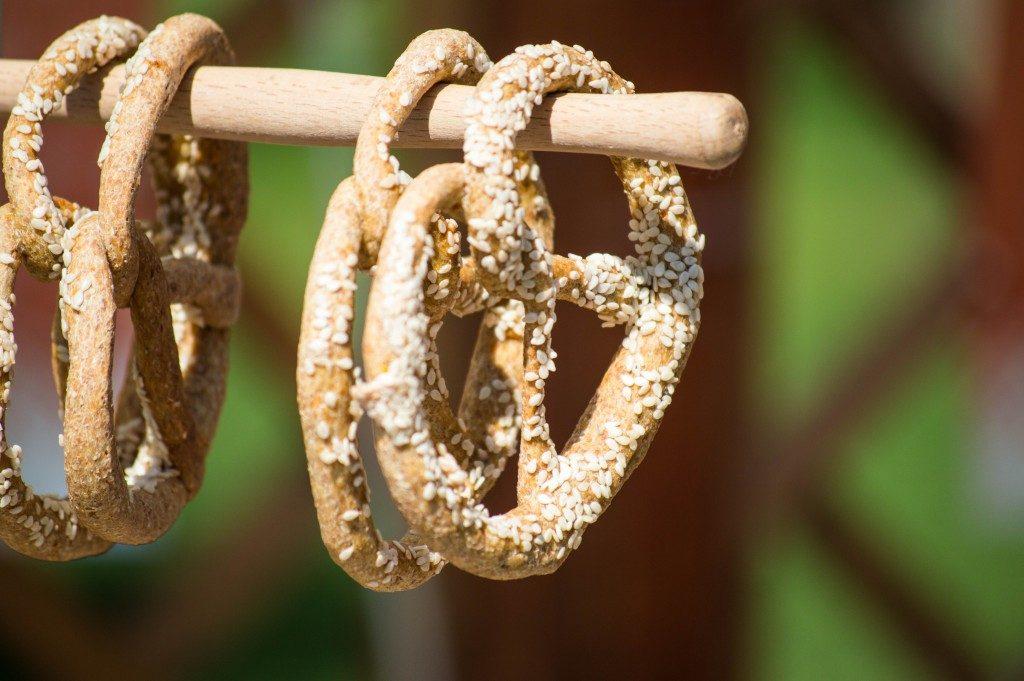 Pretzels hanging on a stick