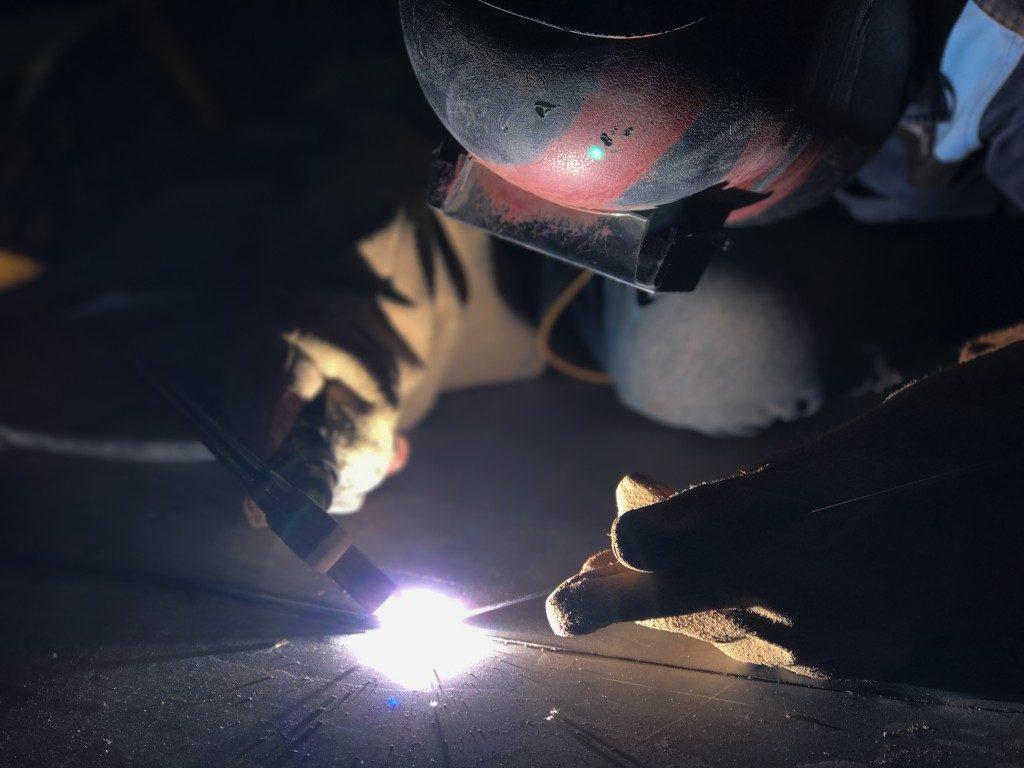 man using welding wire