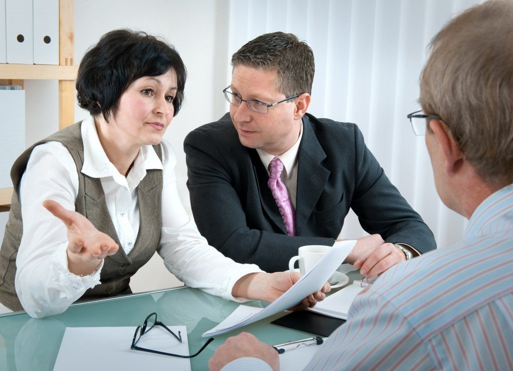 Couple having a conversation with a divorce attorney