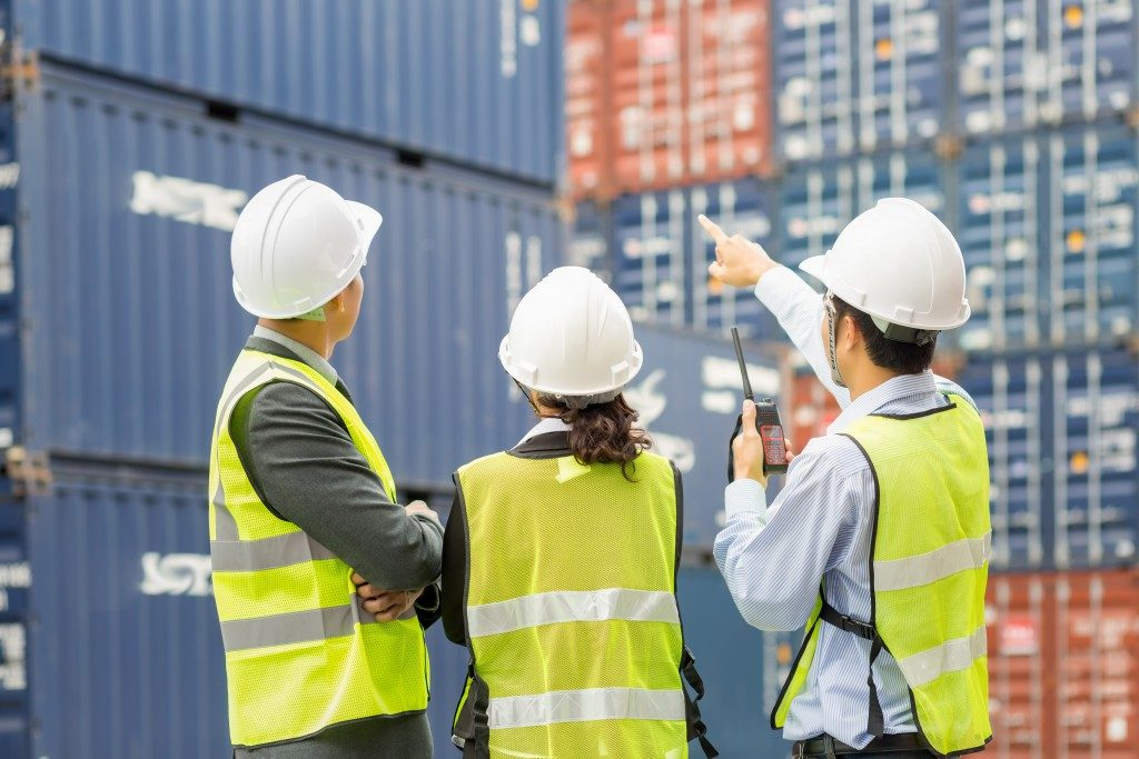 Container inspectors in shipping dock