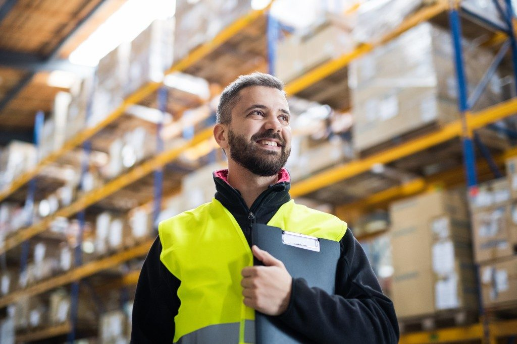 Warehouse worker wearing safety vest