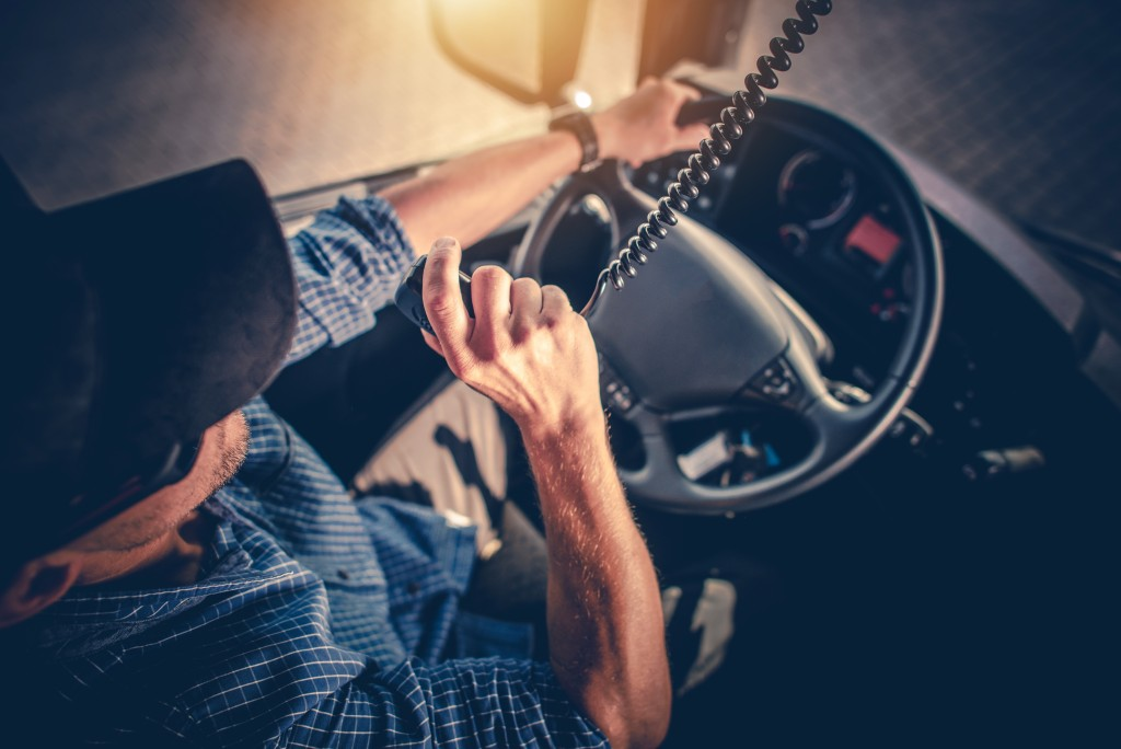 Truck driver using the radio