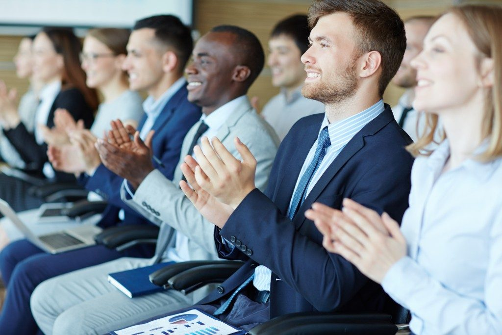 employees clapping at seminar