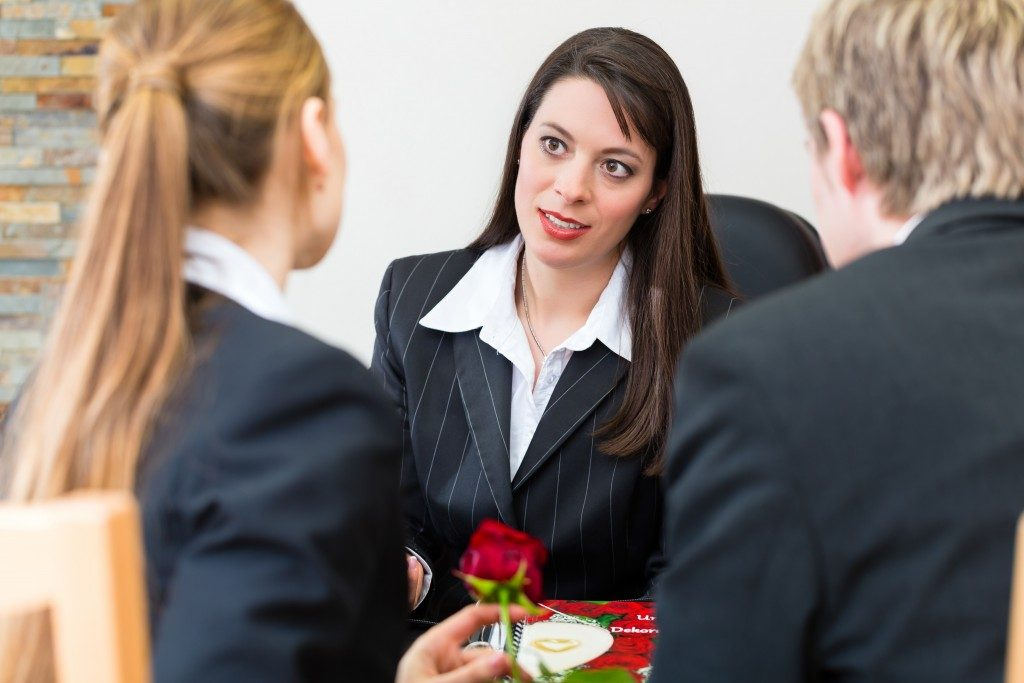 Couple talking to an agent at a funeral home