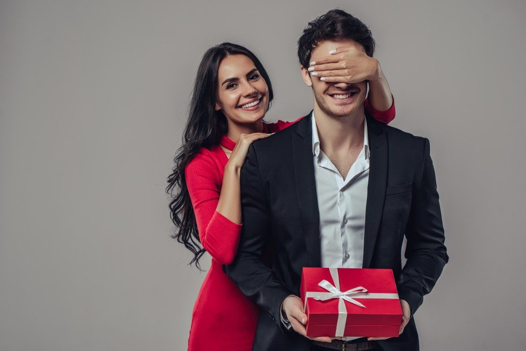 woman giving her loved one a surprise