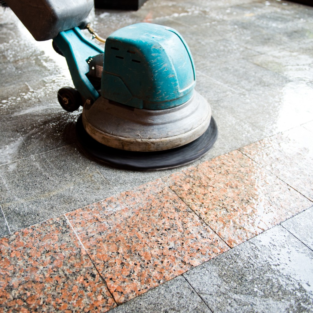 Scrub machine being used to clean the floor