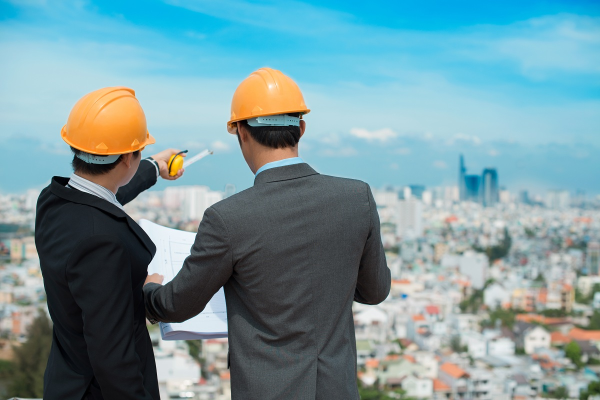 Businessmen looking at construction site