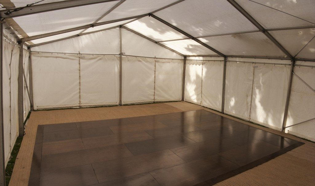 inside a clear span marquee