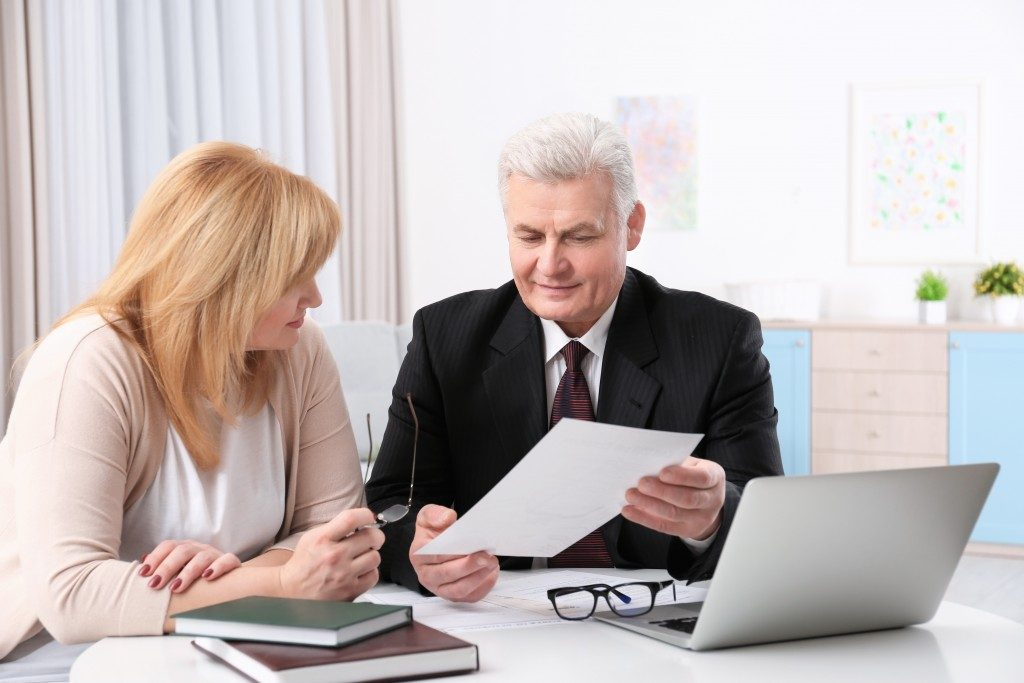 Lawyer showing his client a document