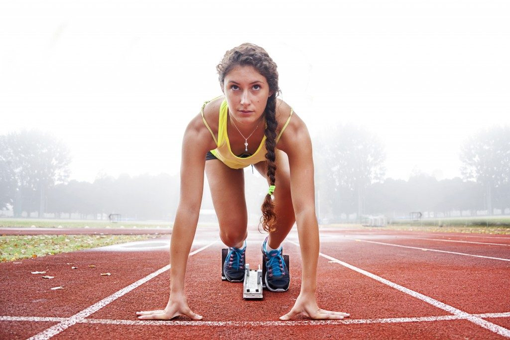woman getting ready to run track
