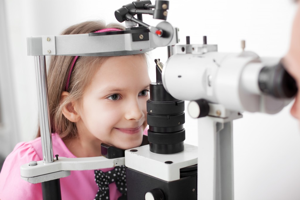 Little girl getting her eyes examined