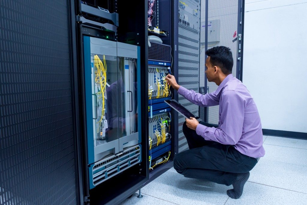 administrator working in data center room