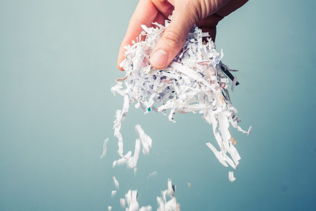 Hand holding shredded paper