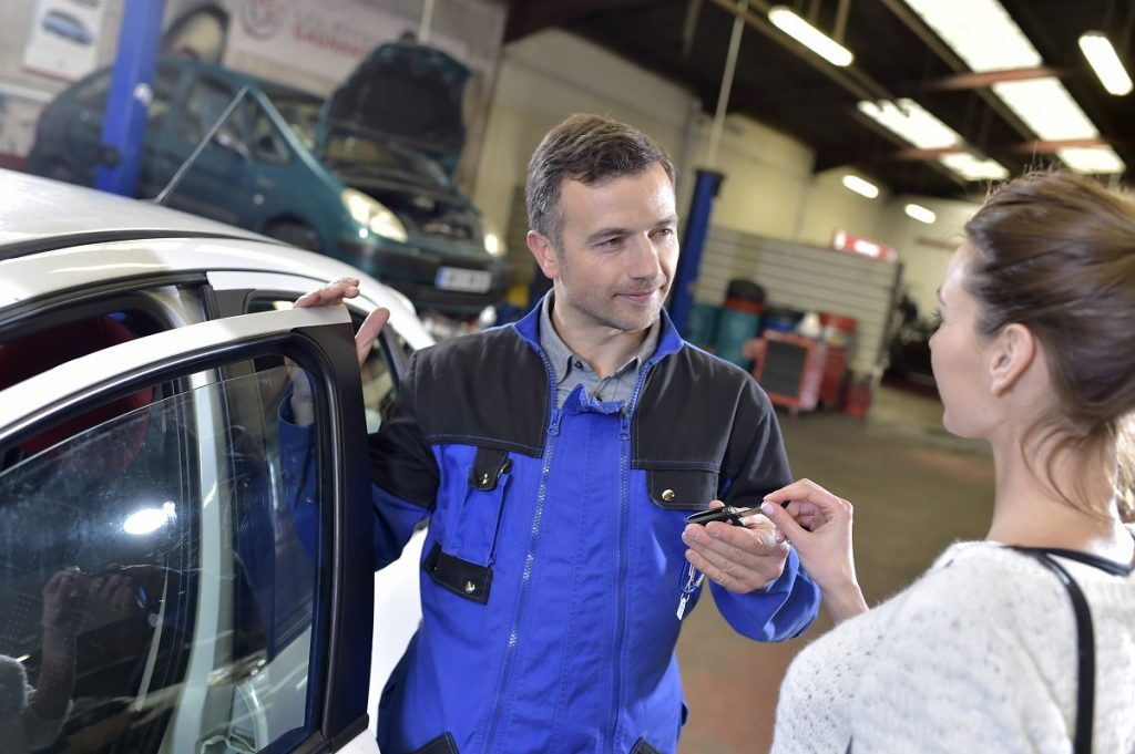 mechanic talking to a customer