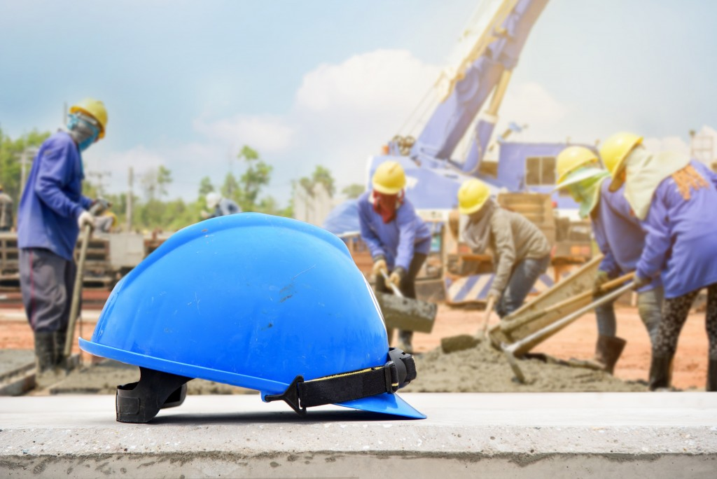 blue safety hat in the constructon site