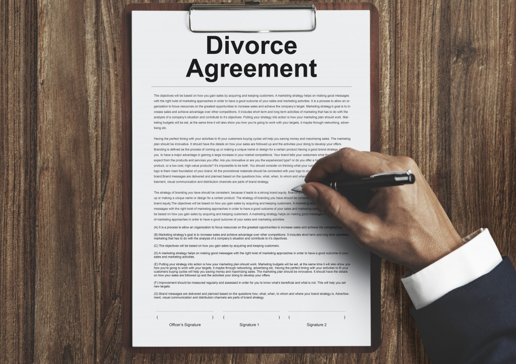 person signing a divorce agreement