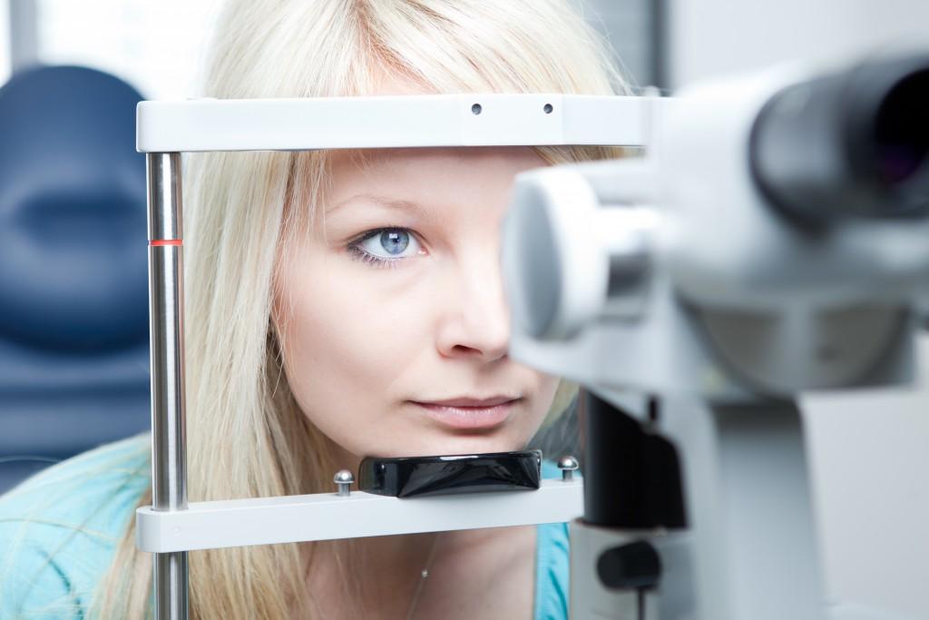 Female having her eyes examined