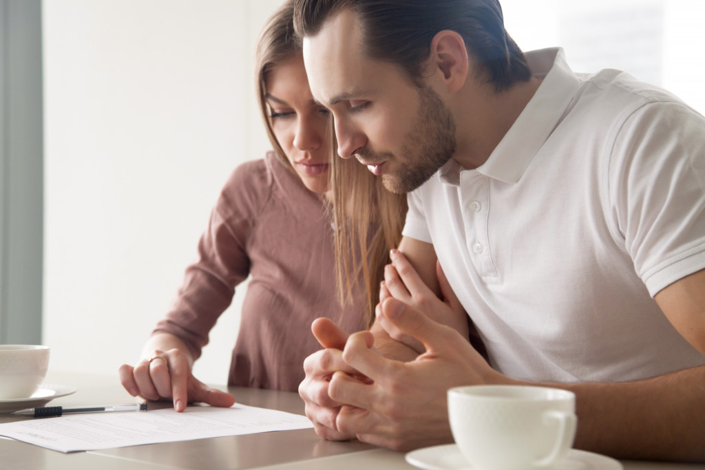 couple looking at paper