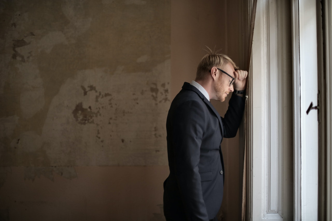 man facing the wall