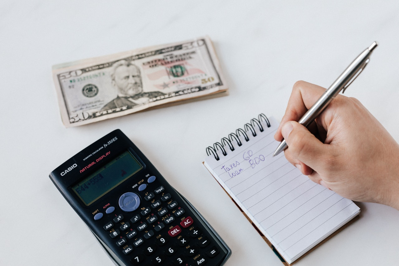person listing down expenses